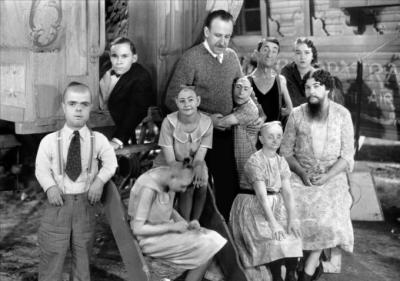 Some of the cast of Freaks (1932) along with Tod Browning (center).